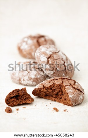 Chocolate crinkles cookies on a linen cloth, shallow dof.