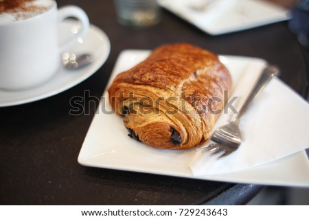 Chocolate Croissant Pastry Pain Au Chocolat with Latte Cappuccino on Cafe Table