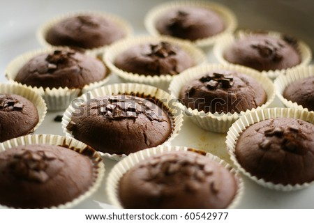 Stock Photo chocolate cupcake in paper  container on white