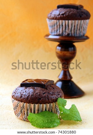 chocolate cupcake with chocolate decoration in pink packaging
