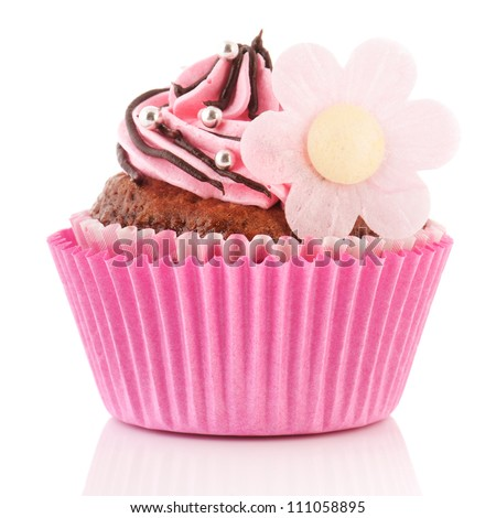 chocolate cupcake with pink butter cream and flower decoration