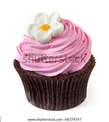 Chocolate cupcake with pink frosting and a white flower, isolated on white.