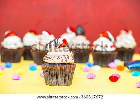 Chocolate Cupcakes on wood vintage background (Selective Focus)