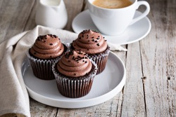 Chocolate cupcakes with a cup of hot black coffee