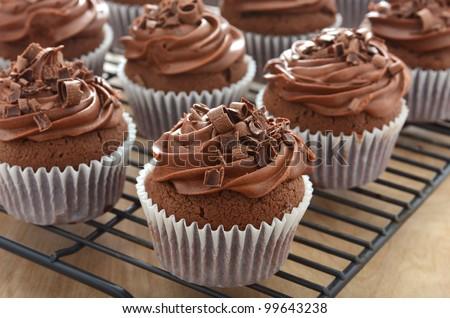 Chocolate cupcakes with chocolate swirl icing #99643238