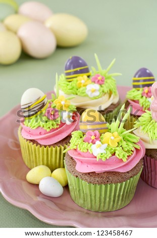 Chocolate cupcakes with vanilla frosting decorated for Easter