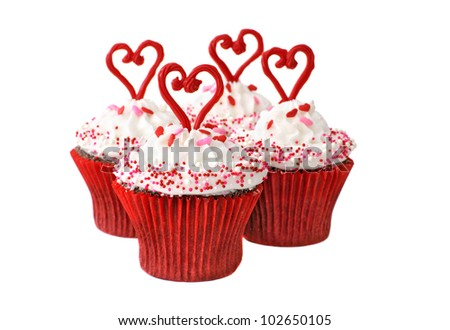 Chocolate cupcakes with vanilla frosting decorated with hearts and sprinkles