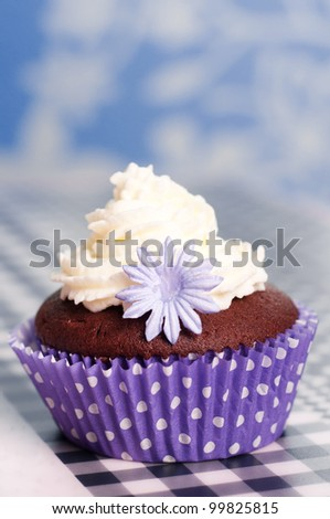 chocolate cupcakes with whipped cream in a purple dotted cup