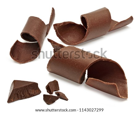 Chocolate curls and parts or broken chocolate morsels isolated on white background with clipping path