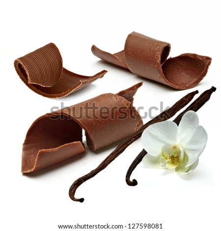 Chocolate Curls With Vanilla Beans On White Background