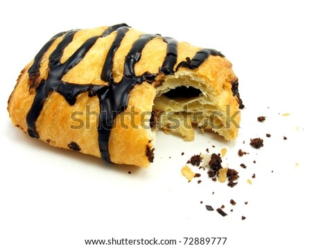 Chocolate danish pastry cake with bite missing & crumbs