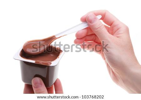 chocolate dessert and teaspoon isolated on white
