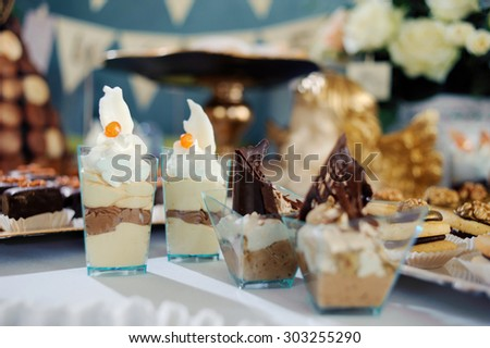 chocolate desserts in parfait cups on a white table, decor with chocolate desserts, festive table with desserts.