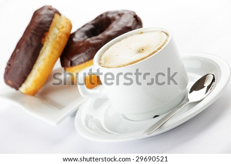 Chocolate donuts with coffee
