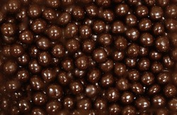 Chocolate dragee. Dark brown chocolate dragee, hazelnut Beans. full frame background. traditional sweets. texture for design.