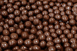 Chocolate dragee. nuts covered chocolate, full frame background. traditional sweets, hazelnut Beans in chocolate