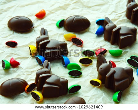 Chocolate Easter Bunnies on Crumpled Paper. Multicolored candy. #1029621409
