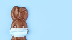 Chocolate Easter bunny wearing a medical face mask.