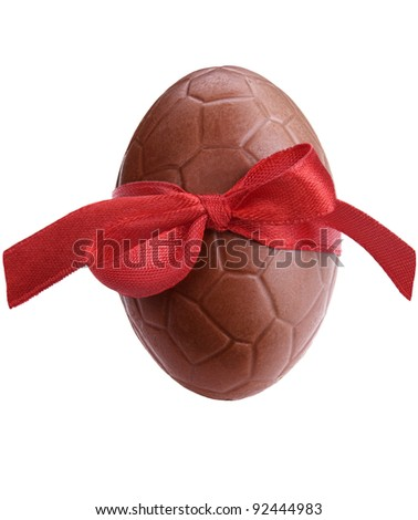 Chocolate easter egg with a red ribbon isolated on white