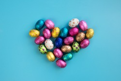 Chocolate Easter eggs in a heart shape. Easter seasonal card concept