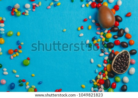 Chocolate Easter eggs with color ribbon bows #1049821823
