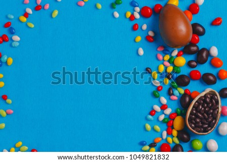 Chocolate Easter eggs with color ribbon bows #1049821832