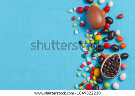 Chocolate Easter eggs with color ribbon bows #1049822210