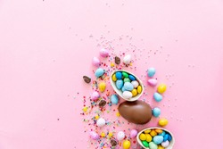 Chocolate Easter eggs with multi-colored candy decorations. Copy space