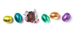 Chocolate easter eggs wrapped in multicolored foil isolated on white background
