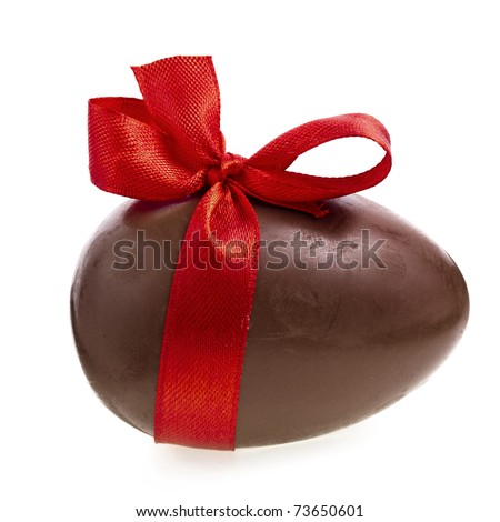 Chocolate egg with a red ribbon bow isolated on white