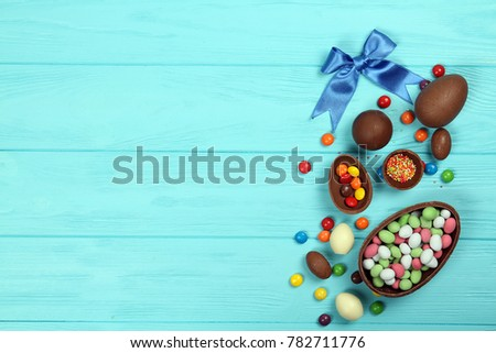 Chocolate eggs and sweets on a blue background. Easter #782711776
