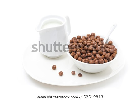 chocolate flakes and a jug of milk for breakfast, isolated on white