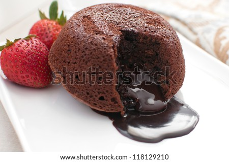 Chocolate fondant lava cake with strawberries
