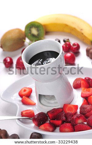 Chocolate fondue served with variety fruits