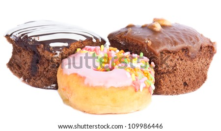 chocolate fudge brownie and pink donut on the white background