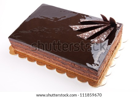 Chocolate glossy dark Cake on white stuffed with nuts
