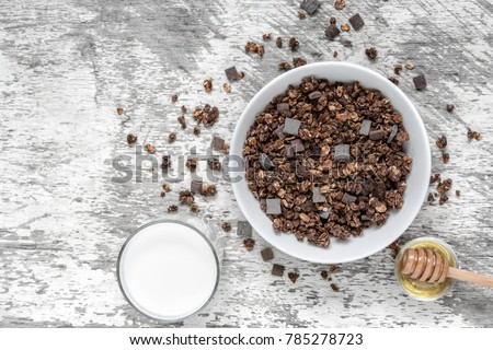 chocolate granola or muesli with milk and honey. healthy breakfast. top view with copy space Stockfoto ©