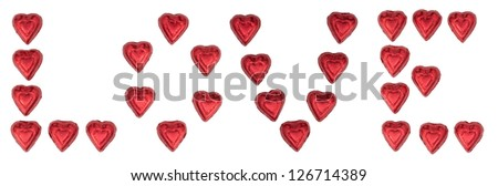 Chocolate heart candy wrapped in red foil arrange to spell out LOVE isolated on white