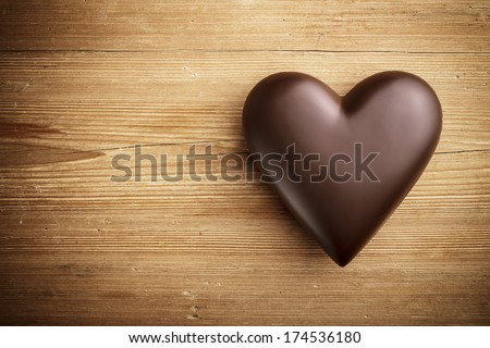 Chocolate heart on wooden background  - stock photo