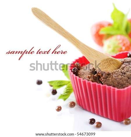 chocolate heart shape muffin in red silicone mold, fresh strawberry and mint (with sample text)