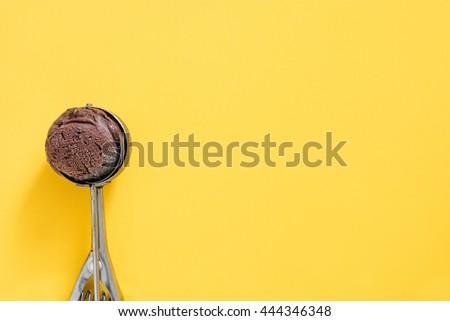 Chocolate ice cream on yellow background