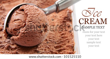Chocolate ice cream scoop, scooped out of a container with copy space