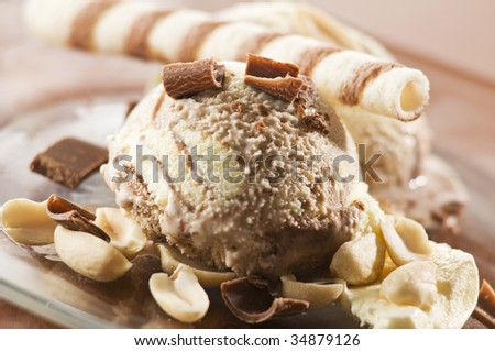 Chocolate ice cream with nuts close up