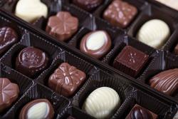 Chocolate in the box. Specially packaged gift chocolate - pistachio, hazelnut, walnut.
