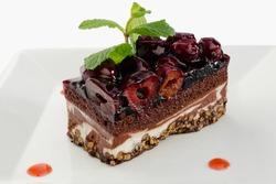 Chocolate layered cake with dark cherries