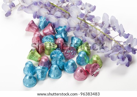 chocolate little bells with flowers, on white background