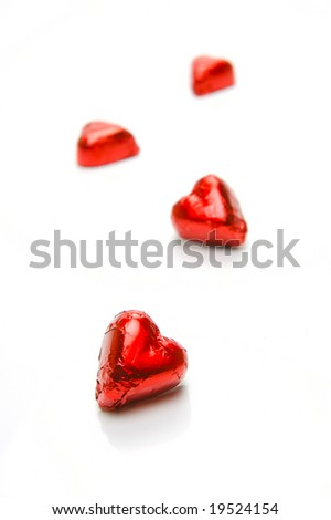 Chocolate love hearts isolated against a white background