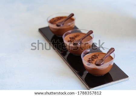 Chocolate low calorie mousse in portion glasses, fluffy vegan dessert with chocolate decorations  Photo stock ©