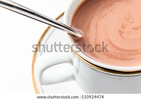 Chocolate milk in white mug, macro shot.