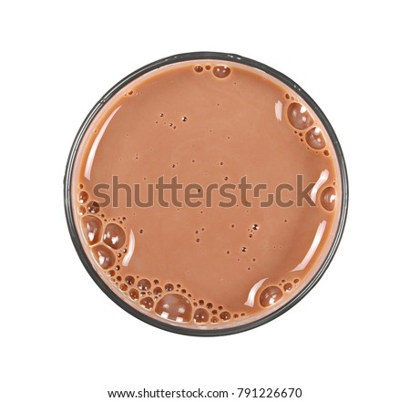 Chocolate milk puddle in glass isolated on white background, top view